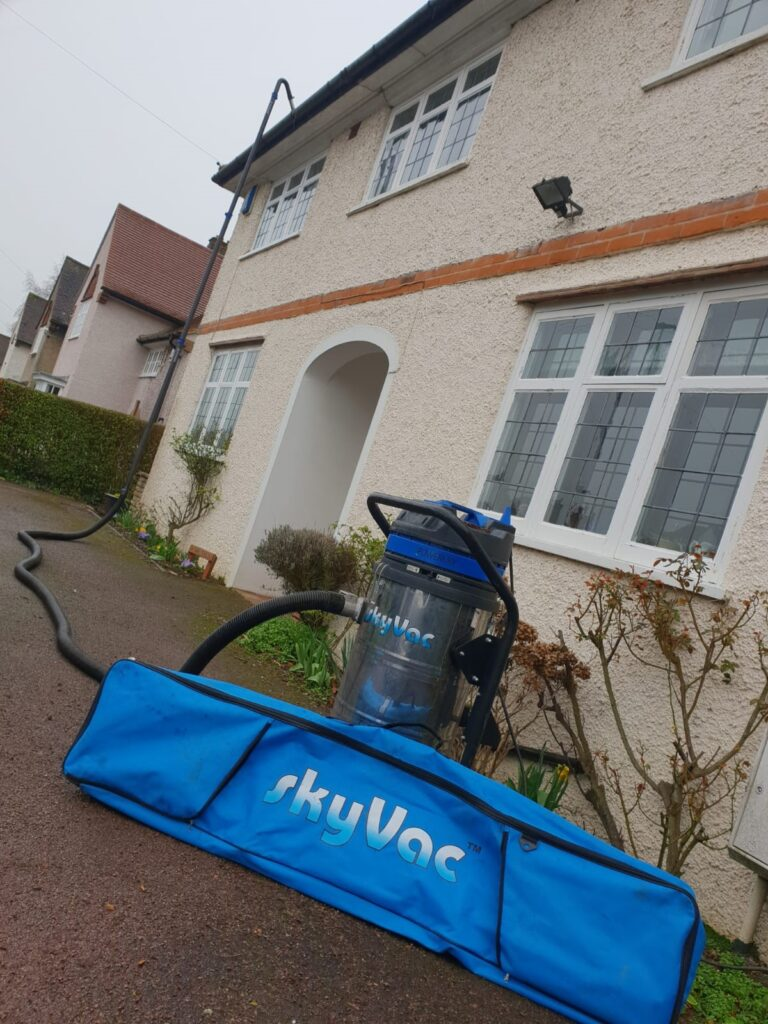 SkyVac System used to clean home gutters
